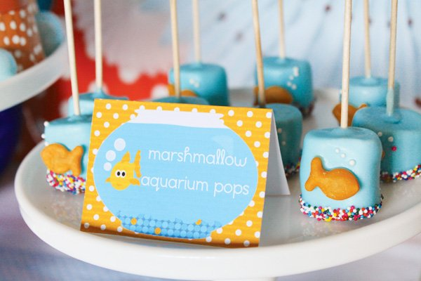 Marshmallow pops with goldfish crackers and sprinkles