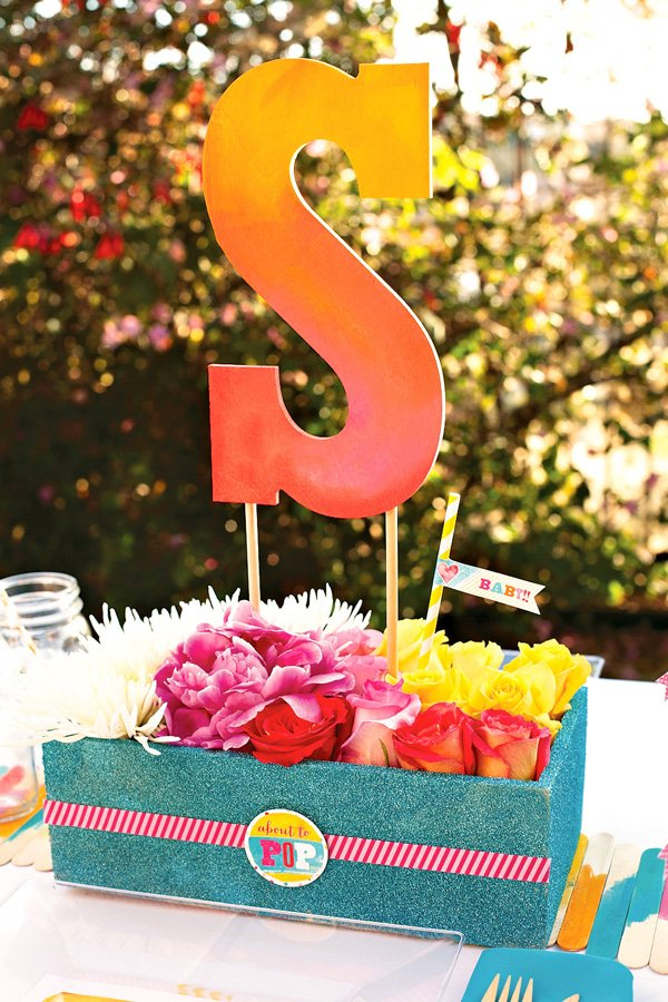 colorful personalized centerpiece with glittered box and flowers