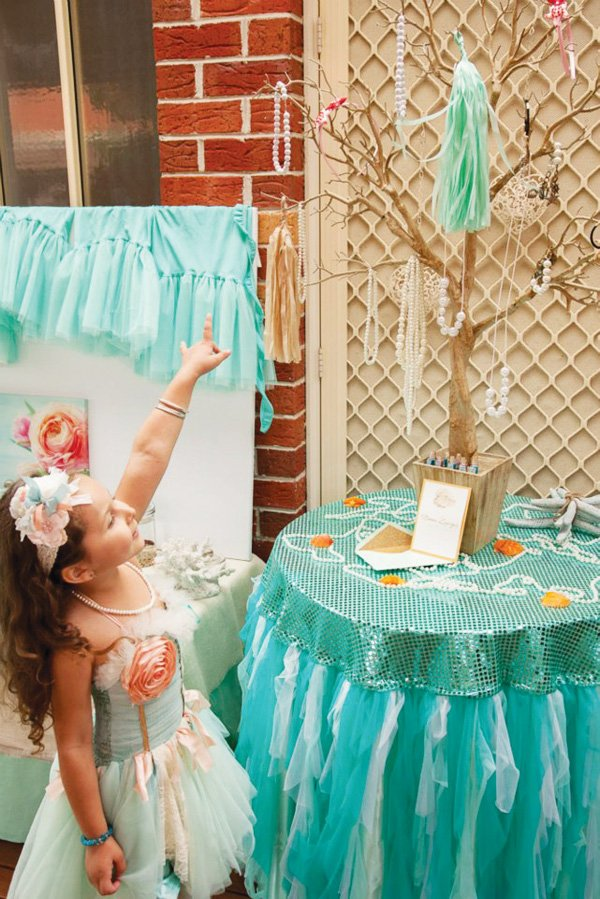 Party tassel tree with hanging costume pearl jewelry