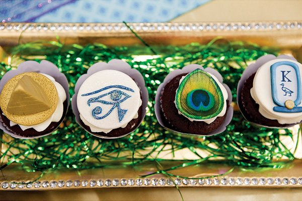 Egyptian Themed Cupcakes with a Peacock Feather Topper
