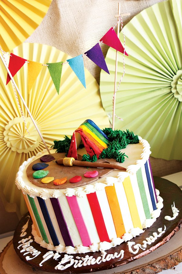 Rainbow Camp party cake with rainbow tent and paint palette toppers