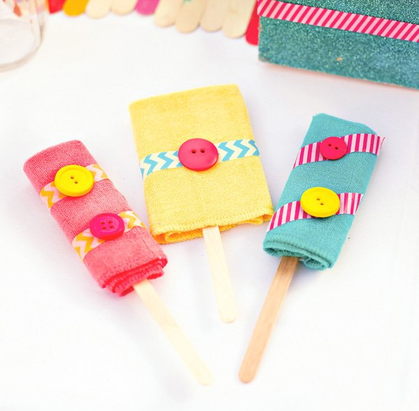 popsicle baby shower decorations made from popsicle sticks and washcloths