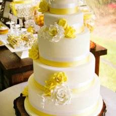 yellow wedding cake with fondant flowers