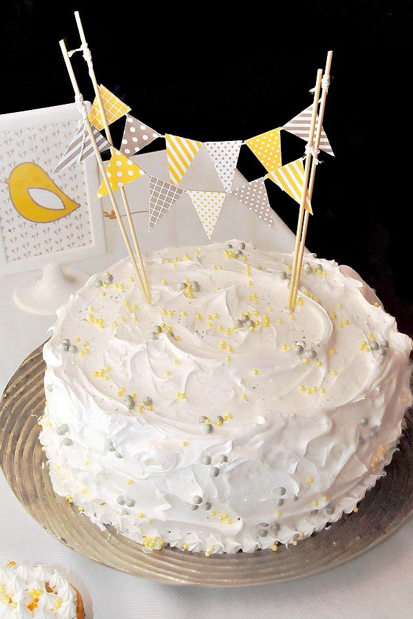 Whimsical cake with yellow and gray mini bunting