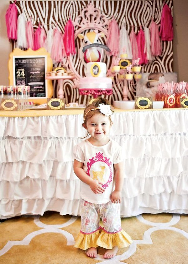 cute birthday girl and her ruffle dessert table