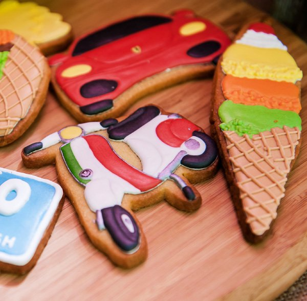 Italy inspired sugar cookies with a scooter and ferrari