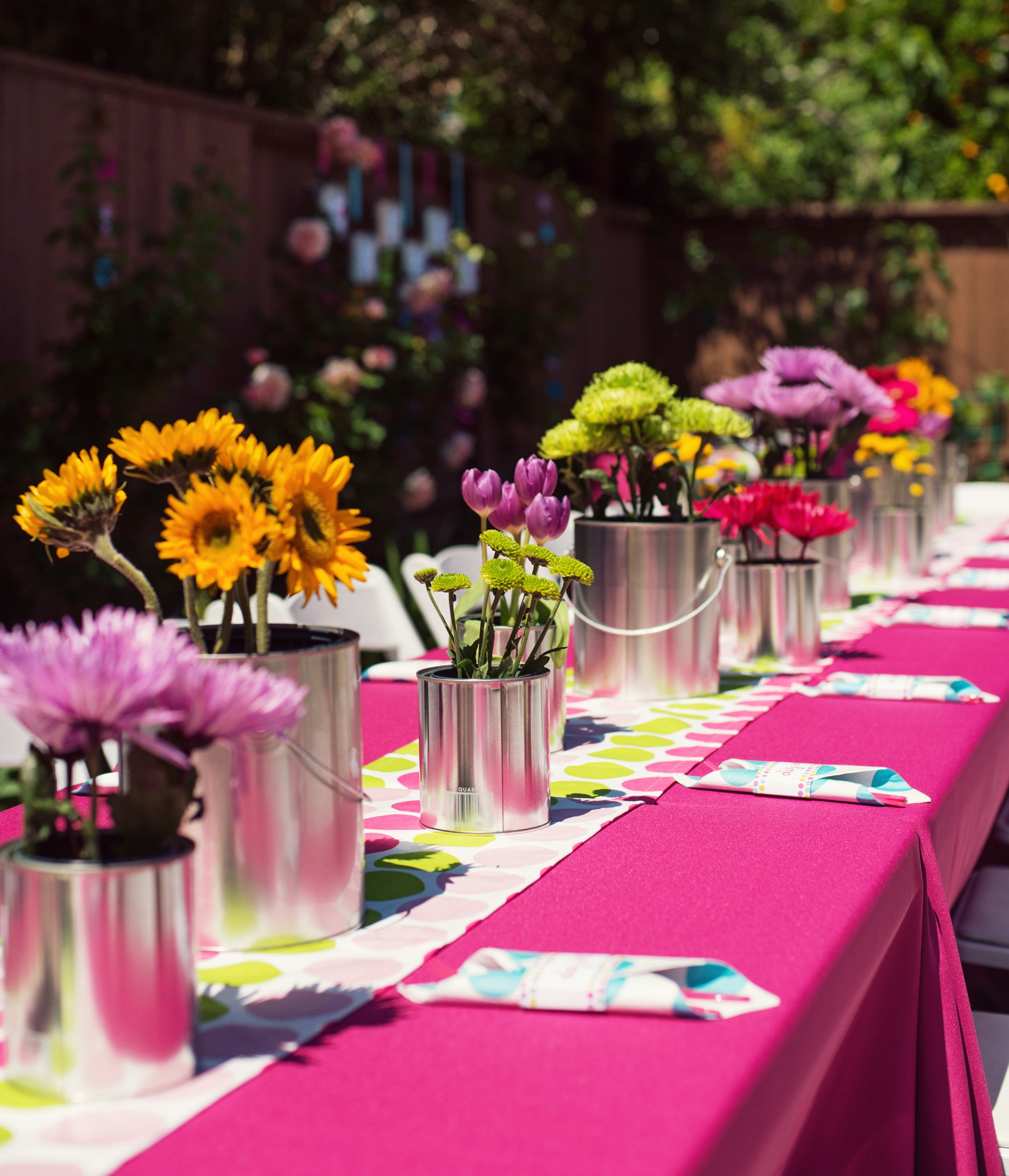 Paint can centerpieces with pretty flowers