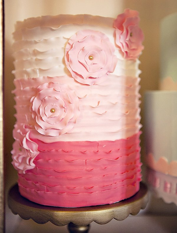Pink ruffle ombre cake with pretty fondant flowers