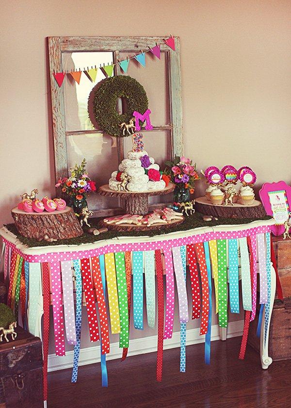 Whimsical rainbow dessert table