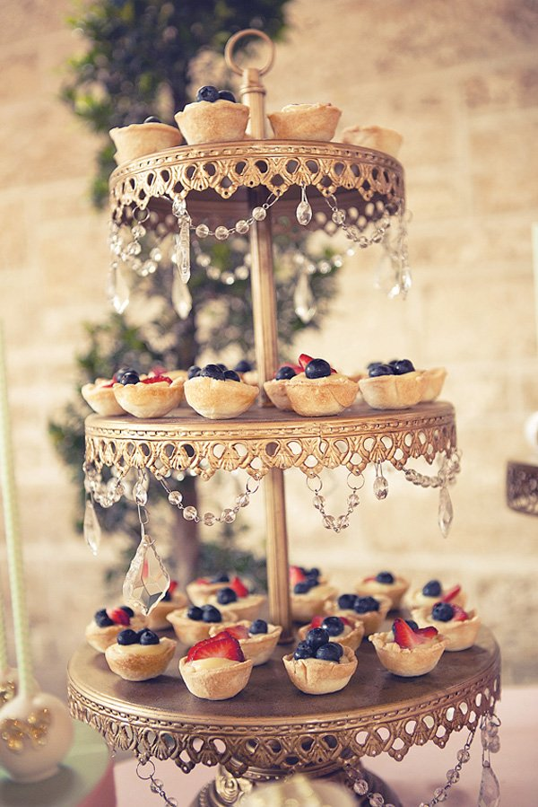 Fruit tarts on a pretty gold riser