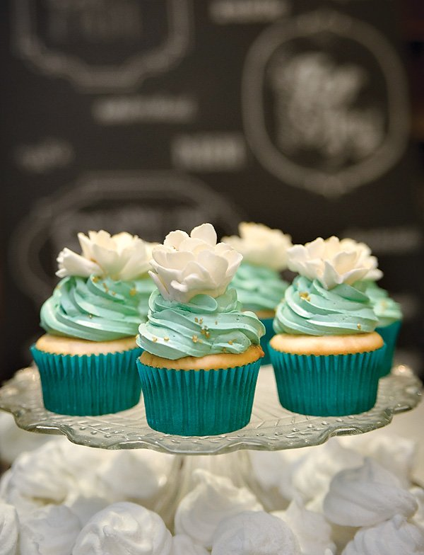 Pretty Emerald Cupcakes with White Flower Toppers