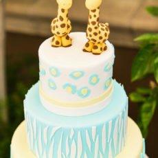 Sweet yellow and blue twins giraffe birthday cake