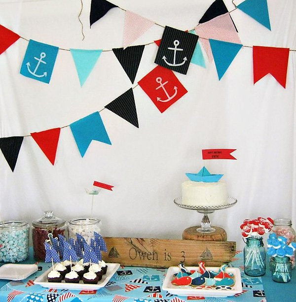 Nautical Dessert Table with Fabric Bunting Backdrop