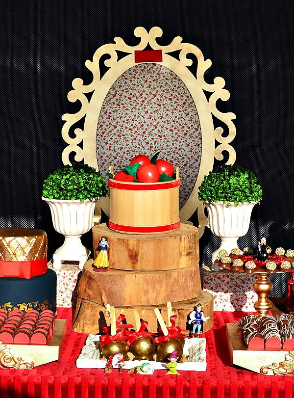 Red gold snow white themed dessert table hostess with