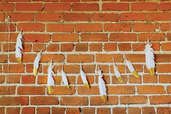 gold feather garland for a dessert table backdrop