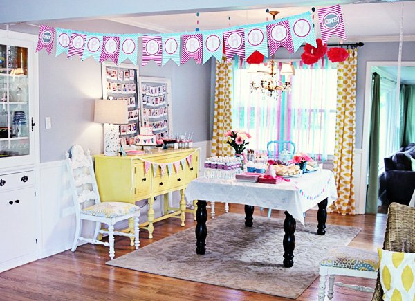 pretty bunting themed first birthday party room