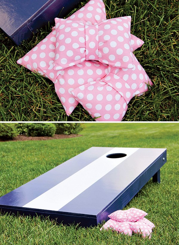 pink and navy cornhole game for a preppy bow tie party