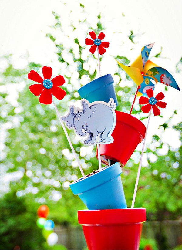 teetering, off-center potted plant centerpiece