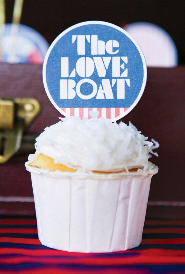 love boat topped coconut cupcake