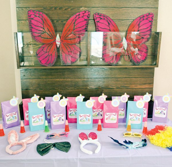 rainbow pony party dress up activity and butterfly decor