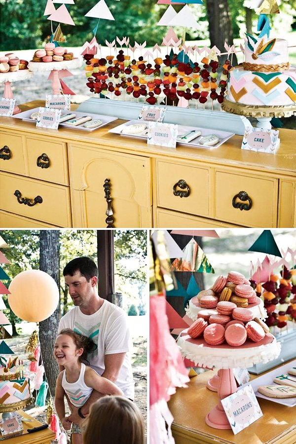 bow and arrow dessert table set up on a vintage yellow dresser