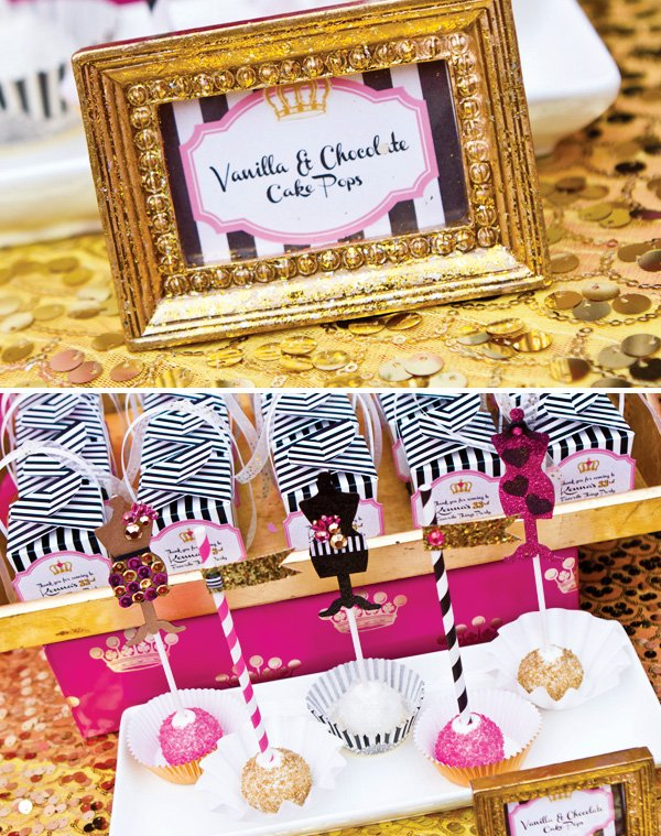 vanilla and chocolate sparkly cake pops with fashionable figure form toppers and a gold frame on a sequined table cloth