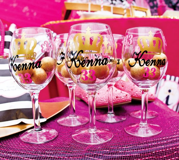 custom painted wine glasses filled with gold glittered gumballs