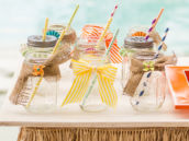 mason jar drinks decorated with ribbon and burlap