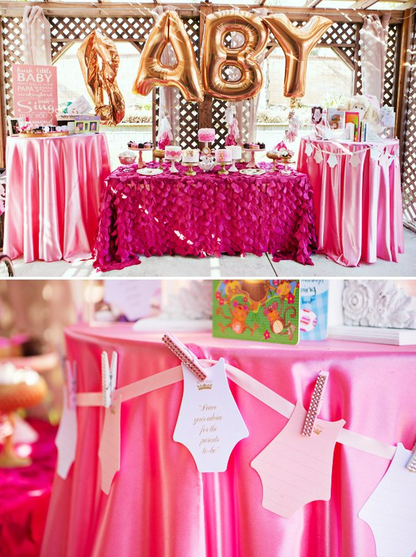 big gold balloons and dessert table