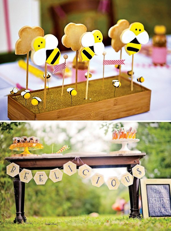 bumble bee sugar cookies on a stick and little fondant bees all go on the dessert table with a beelicious garland