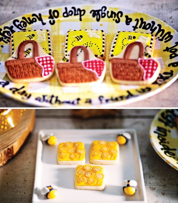 bee themed sugar cookies with honeycomb, picnic baskets and buzzing bumble bees