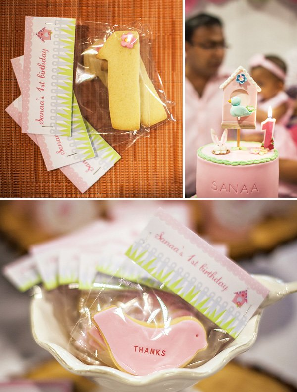 blow out the candles for a bird themed first birthday party and sugar cooke bird and number party favors