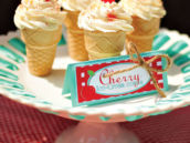 cherry on top cupcakes in ice cream cones on a cake plate