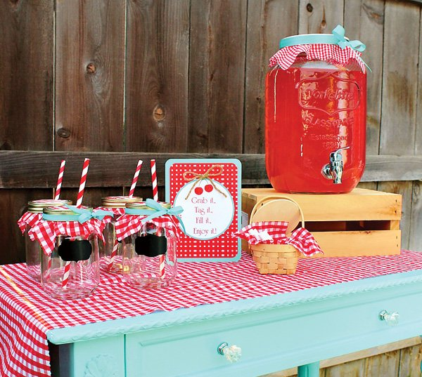 the drink station at a cherry on top themed party