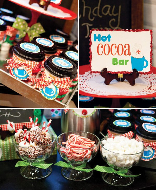 a winter wonderland christmas themed joint birthday party's hot cocoa bar with chocolate dipped marshmallows, candy canes, and red gingham bows