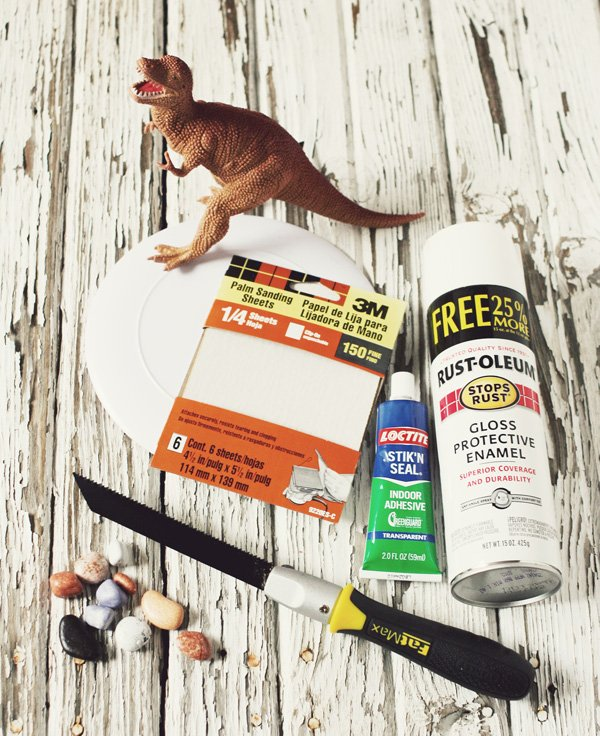 All of the materials needed to make your own dinosaur serving dish
