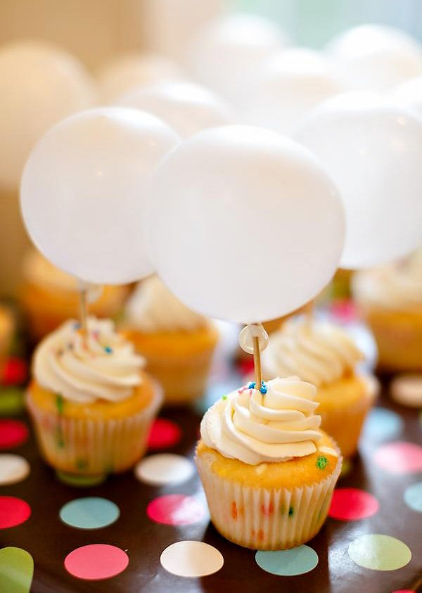 funfetti cupcakes with small white balloon toppers