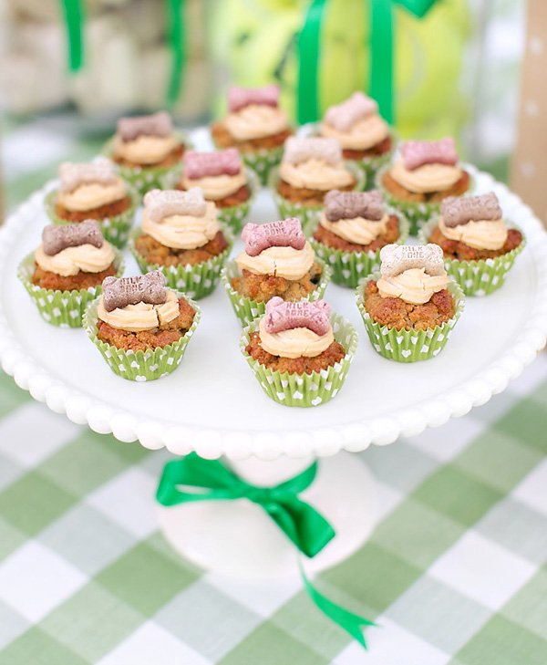 milkbone topped dog cupcakes with peanut butter and carrot for a puppy picnic party
