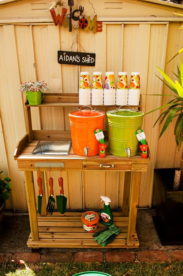 birthday boy gardening shed with colorful drink dispensers