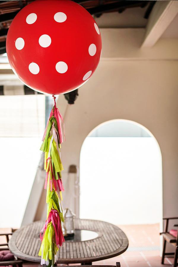 red white polka dot balloon with tissue tassel garland