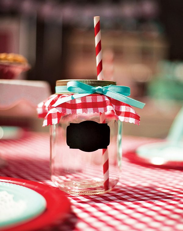 red gingham and teal ribbon decorated mason jar with chalkboard paint for personalization