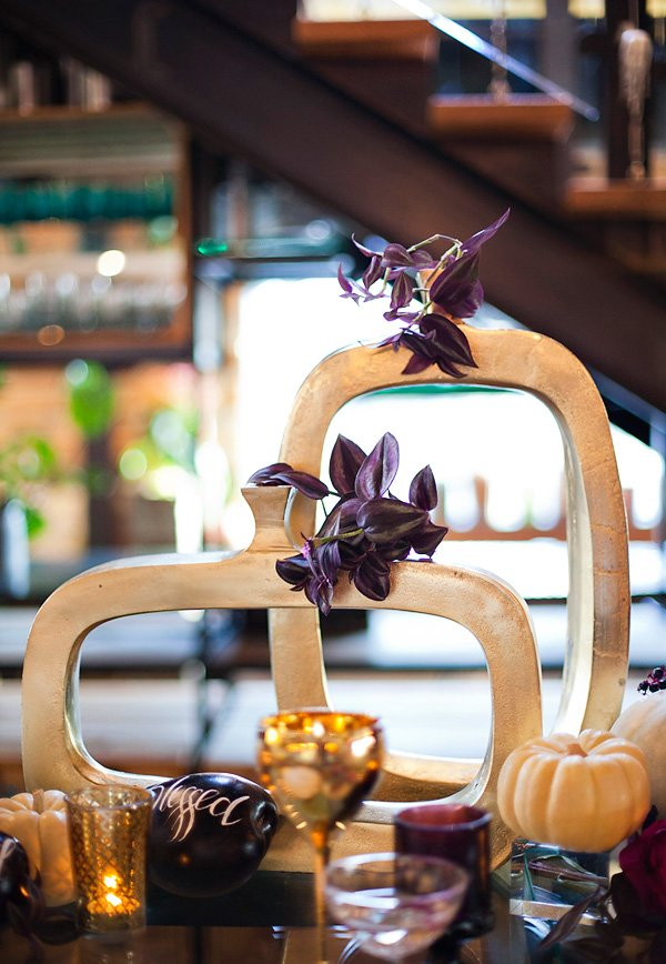 glam, gold painted pumpkin centerpieces with black orchids