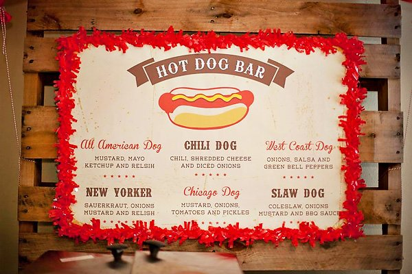 Hot dog bar menu with red border on a wooden pallet - chili dog, west coast dog, new yorker