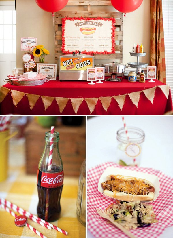 A hot dog buffet for lunch with paper straws, wooden pallets, and burlap bunting