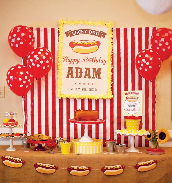 hot dog themed dessert table with hot dog garland, sunflowers, red and ...