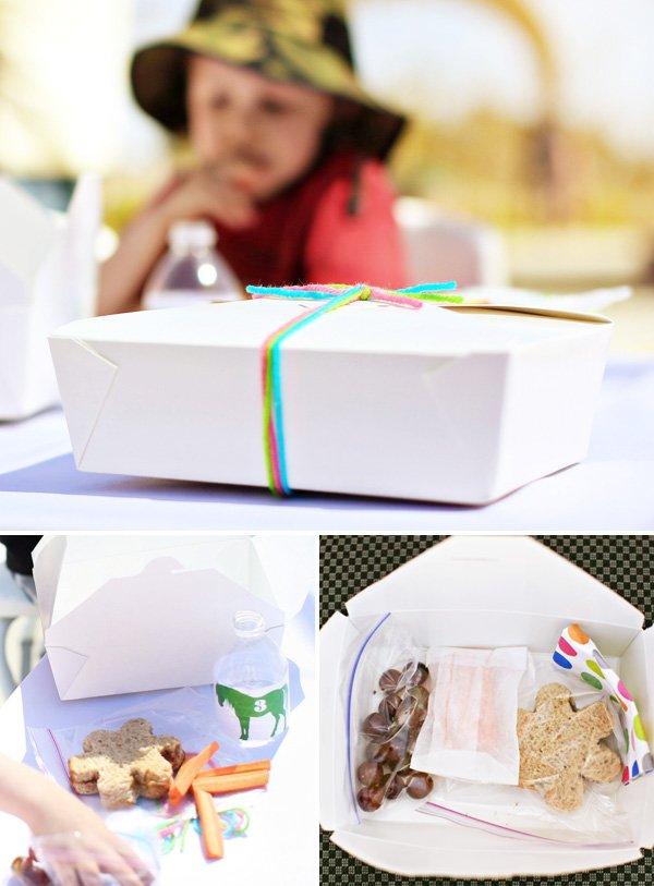 kids takeout lunch box filled with healthy snacks and tied with yarn
