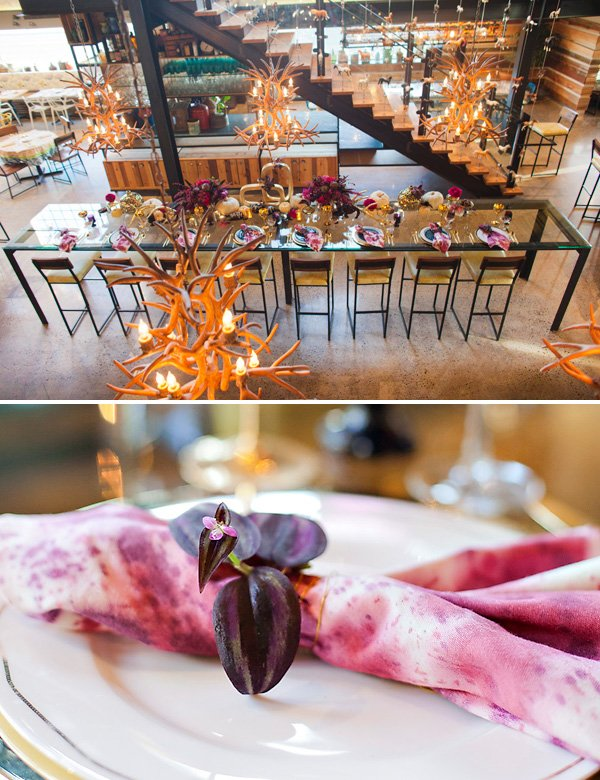 A Modern Glam Thanksgiving table with antler chandeliers and wine-stained napkins
