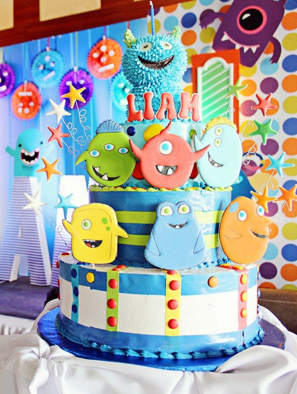 an adorable monster party cake