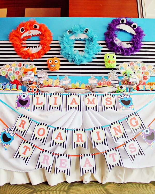 monster dessert table with a really cute backdrop idea