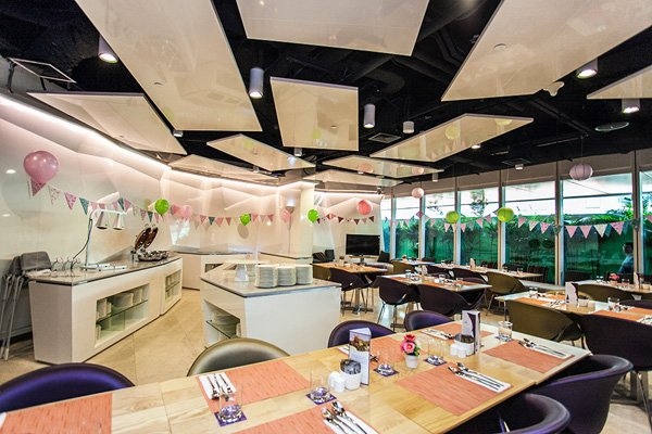bright birthday party venue with bunting and pink and green